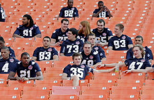 photo - Notre Dame players watch from the stands during Media Day for the BCS National Championship college football game Saturday, Jan. 5, 2013, in Miami. Notre Dame faces Alabama in Monday's championship game.(AP Photo/Chris O'Meara)