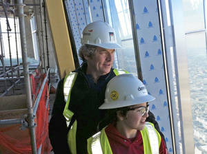 Photo - Xander Moore, 10, and his grandfather, Rick Brown, look out from the top floor of the Devon Tower. For Xander, who is battling cancer, the tower represents a future he yearns to experience firsthand - but he knows he might not get that chance.     ORG XMIT: 1204092241595958