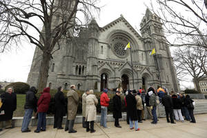 photo - Mourners line up outside Cathedral Basilica of Saint Louis to pay their respects during the public visitation for former St. Louis Cardinals baseball player Stan Musial Thursday, Jan. 24, 2013, in St. Louis. Musial, one of baseball's greatest hitters and a Hall of Famer with the Cardinals for more than two decades, died Saturday, Jan. 19, 2013. He was 92. (AP Photo/Jeff Roberson)