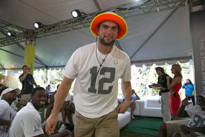 Photo - Indianapolis Colts quarterback Andrew Luck walks out to the stage after being chose in the NFL football Pro Bowl draft, Wednesday, Jan. 22, 2014, in Kapolei, Hawaii. (AP Photo/Marco Garcia)