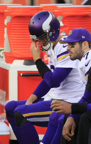 Photo - Minnesota Vikings quarterback Matt Cassel sits on the bench late in the second half of an NFL football game against the Cincinnati Bengals, Sunday, Dec. 22, 2013, in Cincinnati. Cincinnati won 42-14. (AP Photo/Tom Uhlman)