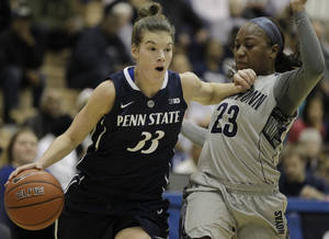 Photo - Penn State's Maggie Lucas (33) moves the ball on Georgetown's Samisha Powell (23) during the first half of an NCAA college basketball game on Sunday, Dec. 8, 2013, in Washington. (AP Photo/Luis M. Alvarez)