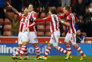 Photo - Stoke City's Stephen Ireland, left, celebrates scoring against Chelsea during the English Premier League soccer match at the Britannia Stadium, Stoke, England, Saturday. Dec. 7 2013. (AP Photo/Dave Thompson, PA Wire) UNITED KINGDOM OUT  -  NO SALES  -  NO ARCHIVES