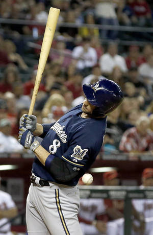Photo - Milwaukee Brewers' Ryan Braun gets hit by a pitch thrown by Arizona Diamondbacks' Evan Marshall during the seventh inning of a baseball game on Tuesday, June 17, 2014, in Phoenix.  Marshall was ejected from the game for the throw. (AP Photo/Ross D. Franklin)