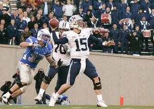 Photo - BYU quarterback Max Hall (15) has tried to model his game after former Dallas Cowboys star Danny White, who is Hall's uncle. AP PHOTO