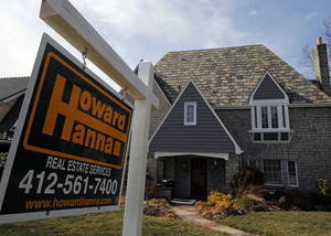 Photo - FILE - This March 5, 2013, file photo  shows a home for sale in Mt. Lebanon, Pa. Freddie Mac reports on mortgage rates for the last week of October on Thursday, Oct. 31, 2013. (AP Photo/Gene J. Puskar, File)