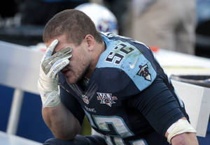 Photo - Tennessee Titans linebacker Colin McCarthy (52) sits on the bench in the final moments of the fourth quarter of a 29-27 loss to the Jacksonville Jaguars in an NFL football game on Sunday, Nov. 10, 2013, in Nashville, Tenn. (AP Photo/Wade Payne)