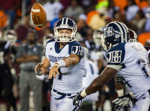 Photo -   Jackson State quarterback Clayton Moore (7) pitches the ball to running back Tommy Gooden (24) during their NCAA college football game against Texas Southern on Saturday, Sept. 15, 2012, in Houston. (AP Photo/Houston Chronicle, Andrew Richardson)