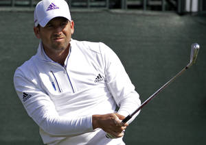 Photo - Sergio Garcia tees off on the first hole during the second round of the Houston Open golf tournament, Friday, April 4, 2014, in Humble, Texas. (AP Photo/Patric Schneider)