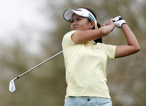 Photo -   Ai Miyazato, of Japan, watches her iron shot off the fourth tee during the third round of the Founders Cup golf tournament Saturday, March 17, 2012, in Phoenix, Ariz. (AP Photo/Paul Connors)