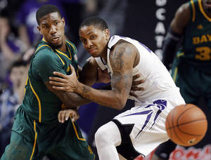 photo - Baylor guard A.J. Walton (22) and Kansas State guard Rodney McGruder (22) watch a loose ball during the first half of an NCAA college basketball game in Manhattan, Kan., Saturday, Feb. 16, 2013. (AP Photo/Orlin Wagner)