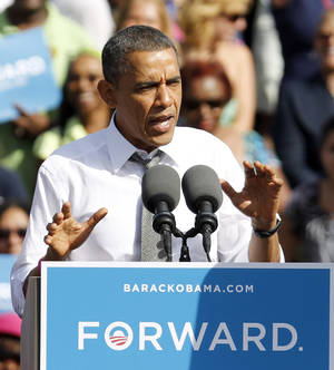 Photo -   President Barack Obama speaks to supporters as he lays out his plan to move the country forward, Tuesday, Oct. 23, 2012, during a campaign stop in Delray Beach, Fla. (AP Photo/Alan Diaz)