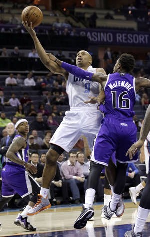 Photo - Charlotte Bobcats' Gerald Henderson (9) drives past Sacramento Kings' Ben McLemore (16) during the first half of an NBA basketball game in Charlotte, N.C., Tuesday, Dec. 17, 2013. (AP Photo/Chuck Burton)
