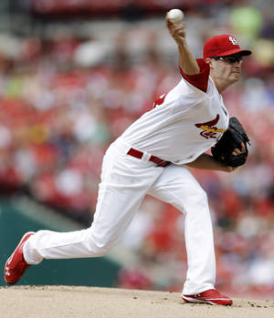 Photo -   St. Louis Cardinals starting pitcher Joe Kelly throws during the first inning of a baseball game against the New York Mets, Monday, Sept. 3, 2012, in St. Louis. (AP Photo/Jeff Roberson)