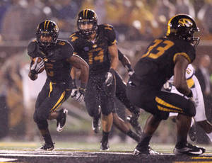Photo -   Missouri punt returner Marcus Murphy returns a punt 70 yards for a touchdown in third quarter action during a game between Missouri and Southeastern Louisiana on Saturday, Sept. 1, 2012 at Faurot Field in Columbia, Mo. (AP Photo/Chris Lee, St. Louis Post-Dispatch)