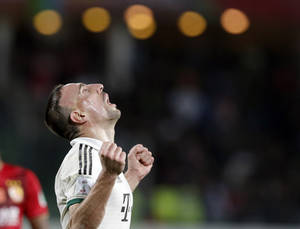 Photo - Bayern's Franck Ribery celebrates after scoring a goal during the semi final soccer match between Guangzhou Evergrande and Bayern Munich at the Club World Cup soccer tournament in Agadir, Morocco, Tuesday, Dec. 17, 2013. (AP Photo/Christophe Ena)
