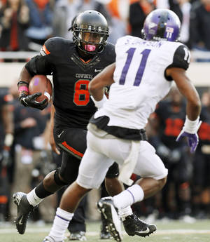 Photo - Oklahoma State's Daytawion Lowe (8) returns an interception past TCU's Skye Dawson (11) in the fourth quarter during a college football game between Oklahoma State University (OSU) and Texas Christian University (TCU) at Boone Pickens Stadium in Stillwater, Okla., Saturday, Oct. 27, 2012. OSU won, 36-14. Photo by Nate Billings, The Oklahoman