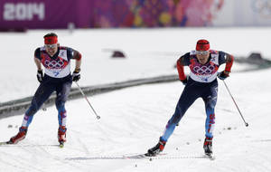 Photo - Russia's Alexander Legkov skis to win the gold during the men's 50K cross-country race at the 2014 Winter Olympics, Sunday, Feb. 23, 2014, in Krasnaya Polyana, Russia. (AP Photo/Matthias Schrader)