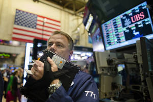 photo -   FILE - In this Oct. 26, 2012, file photo, trader F. Hill Creekmore works on the floor of the New York Stock Exchange, in New York. Stock futures are lower Monday, Nov. 5, 2012, in very light trading with many investors standing down a day before what could be one of the closest presidential elections in U.S. history. (AP Photo/John Minchillo, File)