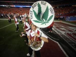 Photo - GLENDALE, AZ - JANUARY 02:  A member of the Stanford Cardinal marching band performs against the Oklahoma State Cowboys during the Tostitos Fiesta Bowl on January 2, 2012 at University of Phoenix Stadium in Glendale, Arizona.  (Photo by Donald Miralle/Getty Images)