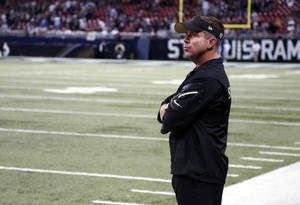 Photo - New Orleans Saints head coach Sean Payton watches from the sidelines during closing seconds of an NFL football game against the St. Louis Rams Sunday, Dec. 15, 2013, in St. Louis. The Rams won 27-16. (AP Photo/Charles Rex Arbogast)