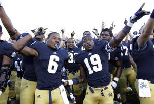 photo -   Notre Dame cornerback KeiVarae Russell (6) and wide receiver Davonte' Neal (19) celebrate following an NCAA college football game against Purdue in South Bend, Ind., Saturday, Sept. 8, 2012. Notre Dame defeated Purdue 20-17. (AP Photo/Michael Conroy)
