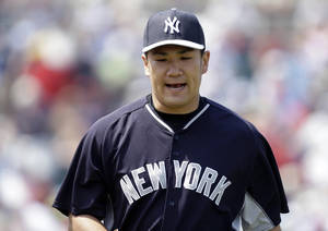Photo - New York Yankees starting pitcher Masahiro Tanaka reacts as he walks off the mound at the end of the third innings of an exhibition baseball game against the Minnesota Twins in Fort Myers, Fla., Saturday, March 22, 2014. (AP Photo/Gerald Herbert)