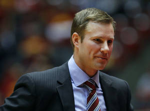 Photo - Iowa State coach Fred Hoiberg smiles during the second half of an NCAA college basketball game against Baylor, Saturday, Jan. 15, 2011, in Ames, Iowa. Iowa State won 72-57. (AP Photo/Charlie Neibergall) ORG XMIT: IACN111