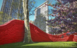 "Photo - Part of more than 1.4 million feet of painted, hand-knotted-rope by artist Orly Gender titled ""Red, Yellow and Blue,"" is installed in Madison Square Park on Wednesday, May 1, 2013 in New York. The installationwill be on view until Sept. 8.   (AP Photo/Bebeto Matthews)"