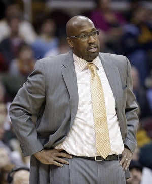 Photo - Cleveland Cavaliers head coach Mike Brown watches during the third quarter of an NBA basketball game against the New Orleans Pelicans, Tuesday, Jan. 28, 2014, in Cleveland. New Orleans defeated Cleveland 100-89. (AP Photo/Tony Dejak)