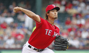 Photo -   Texas Rangers pitcher Yu Darvish throws to a Detroit Tigers batter during the first inning of a baseball game Tuesday, June 26, 2012, in Arlington, Texas. (AP Photo/Tim Sharp)