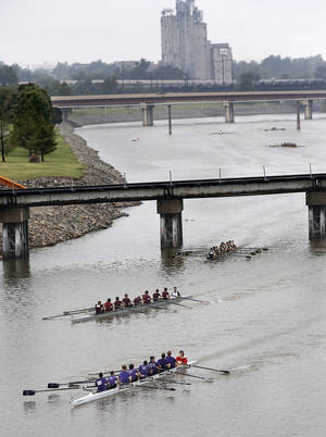 photo - Boats compete on a cloudy, rainy day at the Oklahoma Regatta Festival on the Oklahoma River on Saturday. The event ends Sunday. Photo by Jim Beckel, The Oklahoman