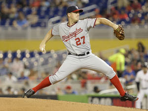 Photo - Washington Nationals starting pitcher Jordan Zimmermann (27) throws during the first inning of the MLB National League  baseball game against the Miami Marlins, Monday, April 14, 2014, in Miami. (AP Photo/Lynne Sladky)