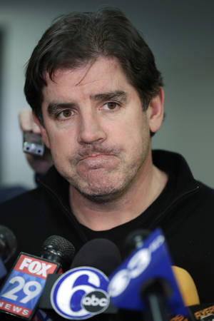 photo - Philadelphia Flyers coach Peter Laviolette speaks with members of the media at the team's NHL hockey training facility Monday, Jan. 7, 2013, in Voorhees, N.J. Ending a bitter dispute that wiped out a large part of the hockey season for the third time in less than two decades, the league and its union agreed to the framework of a 10-year labor contract that will allow a delayed schedule to start later this month.  (AP Photo/Matt Rourke)