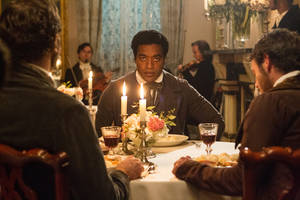 "Photo - This film publicity image released by Fox Searchlight shows Chiwetel Ejiofor in a scene from ""12 Years A Slave."" This year's best picture race at the 86th Academy Awards on Sunday, March 2, 2014, has shaped up to be one of the most unpredictable in years. The favorites are ""12 Years a Slave,"" ""Gravity"" and ""American Hustle."" (AP Photo/Fox Searchlight Films, Jaap Buitendijk, file)"