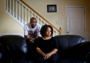 Photo -   Michael, left, and Patricia Jackson are photographed in their home Saturday, June 16, 2012, in Marietta, Ga. On a suburban cul-de-sac northwest of Atlanta, the Jacksons are struggling to keep a house worth $100,000 less than they owe. Their voices and those of many others tell the story of a country that, for all the economic turmoil of the past few years, continues to believe things will get better. But until it does, families are trying to hang on to what they've got left. The Great Recession claimed nearly 40 percent of Americans' wealth, the Federal Reserve reported last week. The new figures, showing Americans' net worth has plunged back to what it was in 1992, left economists shuddering. (AP Photo/David Goldman)