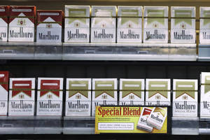 Photo - FILE - In this Wednesday, Oct. 23, 2013, file photo, Marlboro Gold and other Marlboro varieties of cigarettes are displayed in a Little Rock, Ark., store. Altria Group reports quarterly earnings on Thursday, Jan. 30, 2014. (AP Photo/Danny Johnston)