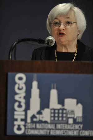 Photo - Federal Reserve Chair Janet Yellen speaks to community development professionals in Chicago at the National Interagency Community Reinvestment Conference in Chicago, Monday, March, 31, 2014. (AP Photo/Paul Beaty)