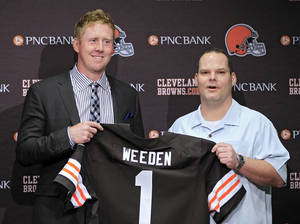 photo - Cleveland Browns first round pick quarterback Brandon Weeden, left, poses with general manager Tom Heckert at the NFL football team's headquarters in Berea, Ohio Friday, April 27, 2012. Weeden was taken with the 22nd overall pick in the 2012 NFL draft. (AP Photo/Mark Duncan) ORG XMIT: OHMD103
