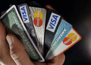Photo - Consumer credit cards are posed in North Andover, Mass.   AP File Photo <strong>Elise Amendola - AP</strong>