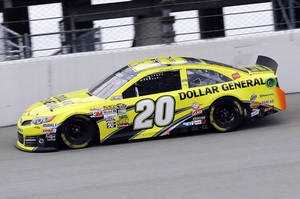 Photo - Matt Kenseth drives his car during the NASCAR Sprint Cup series auto race at Chicagoland Speedway in Joliet, Ill., Sunday, Sept. 15, 2013. (AP Photo/Nam Y. Huh)