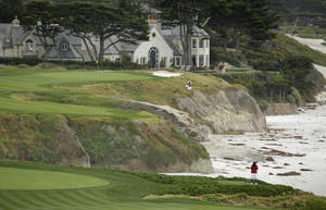 Photo - In this photo taken Friday, Feb. 7, 2014, a marshal at lower right stands on an optional 10th tee of the Pebble Beach Golf Links with the 10th green in the background during the second round of the AT&T Pebble Beach Pro-Am golf tournament in Pebble Beach, Calif. The optional 10th tee is to the right of the ninth green. Officials discovered it in old photos and restored it after they rebuilt the ninth green. Pebble Beach wants the USGA to look at it as a possible forward tee in the 2019 U.S. Open. (AP Photo/Eric Risberg)