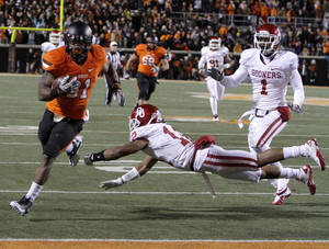 photo - Oklahoma State's Jeremy Smith (31) scores a touchdown past Oklahoma's Jamell Fleming (12) and Oklahoma's Tony Jefferson (1) during the Bedlam college football game between the Oklahoma State University Cowboys (OSU) and the University of Oklahoma Sooners (OU) at Boone Pickens Stadium in Stillwater, Okla., Saturday, Dec. 3, 2011. Photo by Bryan Terry, The Oklahoman