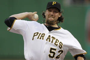 photo - In this July 7, 2012, photo, Pittsburgh Pirates closer Joel Hanrahan delivers during the ninth inning of a baseball game against the San Francisco Giants in Pittsburgh. A person familiar with the talks says the Pirates and the Boston Red Sox are close to completing a trade that would send Hanrahan to Boston for a handful of prospects. Pittsburgh would ship Hanrahan and another player to the Red Sox in exchange for four players, (AP Photo/Gene J. Puskar)