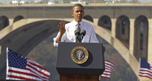 Photo - FILE - In this Nov. 2, 2011, file photo, President Barack Obama speaks in front of the Key Bridge in Washington.  White House official says the Obama administration will intensify its efforts to get Congress to pass legislation that pays for roads and bridge repair. (AP Photo/Pablo Martinez Monsivais, File)