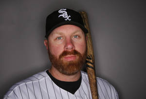 "Photo - FILE - In this Saturday, Feb. 22, 2014 file photo, Chicago White Sox Adam Dunn poses for his photograph during baseball spring training photo day in Glendale, Ariz. Dunn on Thursday, Feb 27, 2014 said he'll be attending this year's Academy Awards with the contingent from the Matthew McConaughey film ""Dallas Buyers Club."" (AP Photo/Paul Sancya, file)"