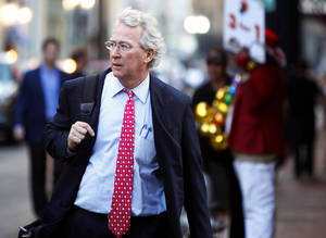 Photo - Chesapeake Energy Corp. CEO Aubrey McClendon walks March 26 through the French Quarter in New Orleans. REUTERS PHOTO <strong>REUTERS</strong>