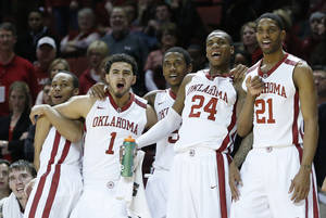 Photo - From left to right, Oklahoma's Jordan Woodard, Frank Booker, Je'lon Hornbeak, Buddy Hield and Cameron Clark, celebrate on the bench late in the second half of an NCAA college basketball game against Baylor in Norman, Okla., Saturday, Feb. 8, 2014. Oklahoma won 88-72. (AP Photo/Sue Ogrocki)
