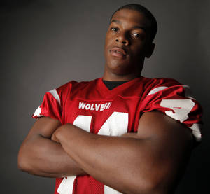 Photo - Jabral Johnson, Lawton, poses for a photo during The Oklahoman's spring high school football photo day in Oklahoma City, Saturday, May 22, 2010.  Photo by Nate Billings, The Oklahoman ORG XMIT: KOD