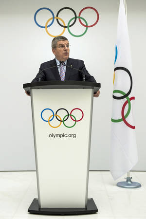 Photo - International Olympic Committee, IOC, President Thomas Bach of Germany, speaks during the announcement of the 2022 Olympic Winter Games Candidate Cities (Beijing 2022, Oslo 2022, Almaty 2022) after an executive board meeting, at the IOC headquarters in Lausanne, Switzerland, on Monday, July 7, 2014. (AP Photo/Keystone,Jean-Christophe Bott)